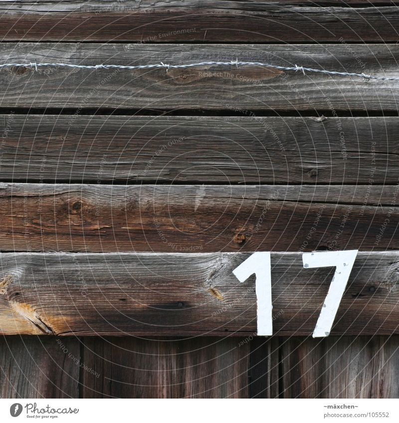 Old White Black Dark Wood Bright Brown Digits and numbers Fence 7 Barbed wire Wood flour 17 Burnt House number Wire netting fence