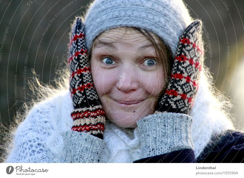 Cuckoo! Surprise Excitement Hand Gloves Winter Cap Twenties Fascinating Marvel Colour photo Exterior shot Day Human being Woman Head Face 1 Person