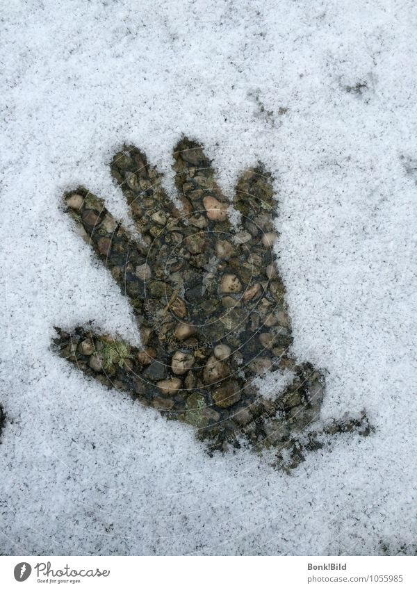 Giving with warm hands Human being Child Hand Elements Earth Snow Warmth Stone Concrete end of winter Thaw warmth of the heart Warm hand Intimacy Touch To talk