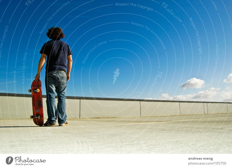 Human being Sky Man Blue Clouds Calm Loneliness Wall (barrier) Wait Concrete Stand Jeans Skateboarding Skateboard Copy Space Blue sky