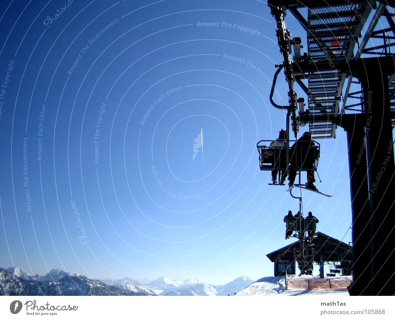 Winter Cold Mountain Snow Aviation Copy Space Sit Beautiful weather Peak Snowcapped peak Hut Skis Upward Ski resort Blue sky Prop