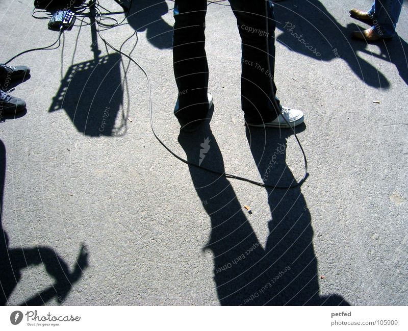 Human being White Sun Street Dark Music Gray Feet Footwear Legs Places Cable Leisure and hobbies Concert Guitar Austria