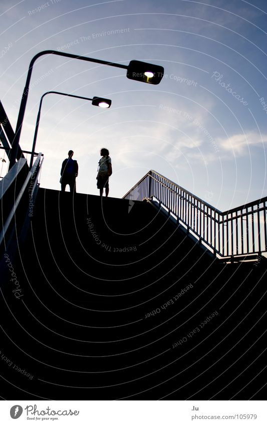 two (1/3) Go up Friendship Back-light Silhouette Lamp Man Direction Street lighting Dark Stand Tread 2 Joy Youth (Young adults) Movement To fall Handrail Sky