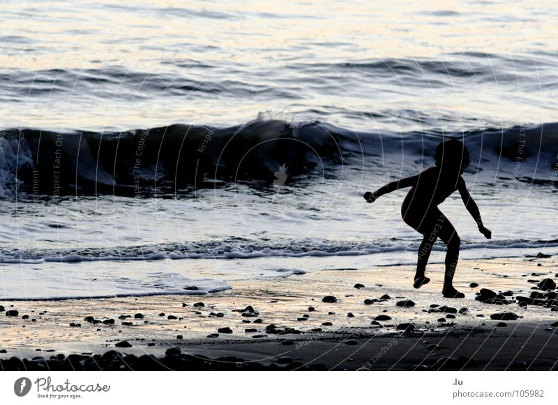 child jumps Vacation & Travel Child Ocean Monster Sunset Playing Jump Waves Beach Joy Contrast tramp Water Sand