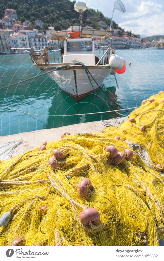 Fishnets on fish boat. Yellow net. Old Ocean Line Watercraft Rope Industry Harbour Fishery Industrial Consistency Maritime Seafood Nylon Nautical