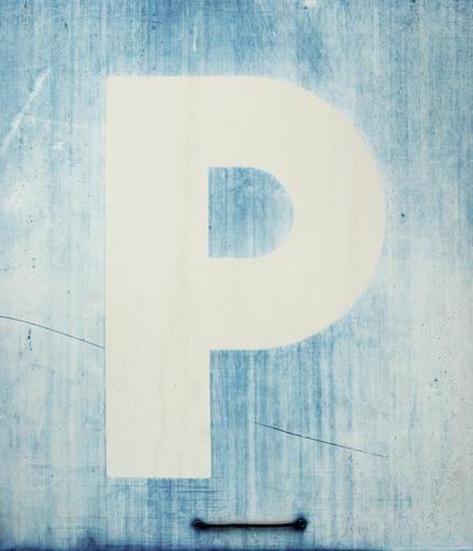 PlaceHolder Transport Road sign Signage Characters Old Simple Blue White Abrasion abraded Shabby Tracks Parking lot Ravages of time Colour photo Exterior shot