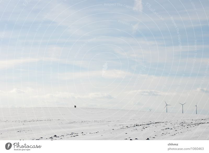 headwind 2 Human being Hiking Blue White Loneliness Far-off places Winter Wind energy plant Energy industry To go for a walk Snow icily Clouds Sky Field Flat