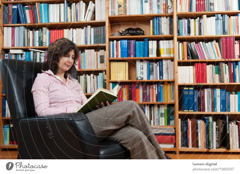 Human being Woman Relaxation Adults Living or residing Sit Book Reading Education Print media Armchair Library Shelves 30 - 45 years Bookshelf Picture book