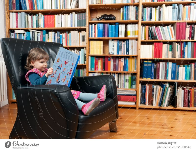 Little girl with book Reading Armchair Education Child Human being Toddler Girl 1 3 - 8 years Infancy Print media Book Library Study Living or residing look