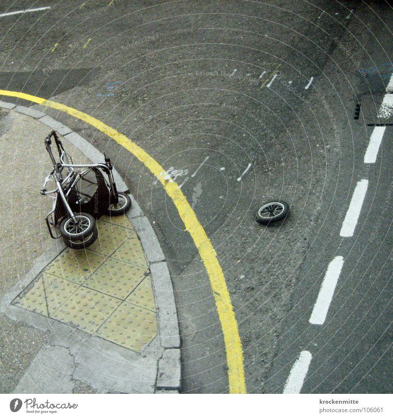 Wheel off Baby carriage Accident Breakdown Stripe Asphalt Transport Dangerous Bird's-eye view Street Lie Damage Traffic lane Curbside Deserted Broken