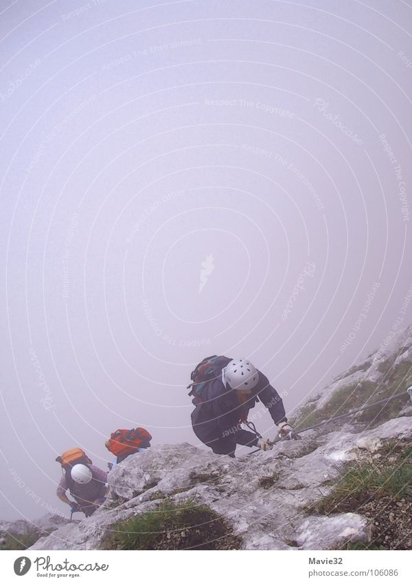 The mountain calls Fog Steep face Joy Leisure and hobbies Sports Playing Mountain Climbing Effort Level via ferrata Above