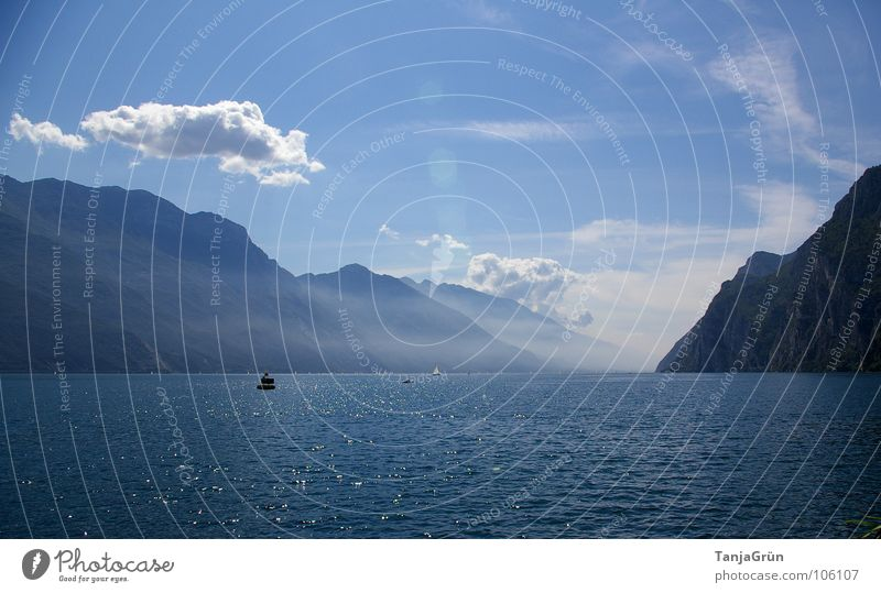 Water Sky Summer Beach Vacation & Travel Clouds Mountain Lake Watercraft Waves Fog Vantage point Italy Bay Lake Garda