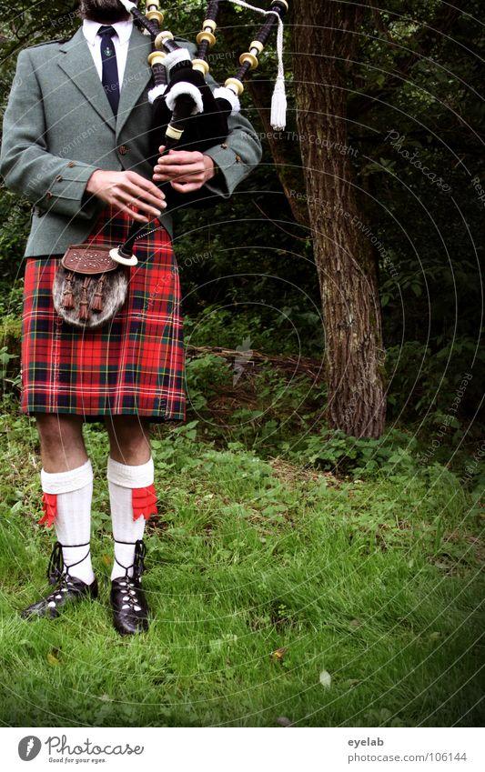 Confrontation of musical legroom Scotsman Kilt Grass Highlands Great Britain Highland Games Band together Squad Playing War Tradition Argument