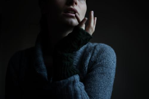 . Skin Face Human being Feminine Woman Adults Mouth Lips Arm Hand Fingers 1 Winter Sweater Knitted sweater Gloves Dark Cold Cuddly Warmth Colour photo