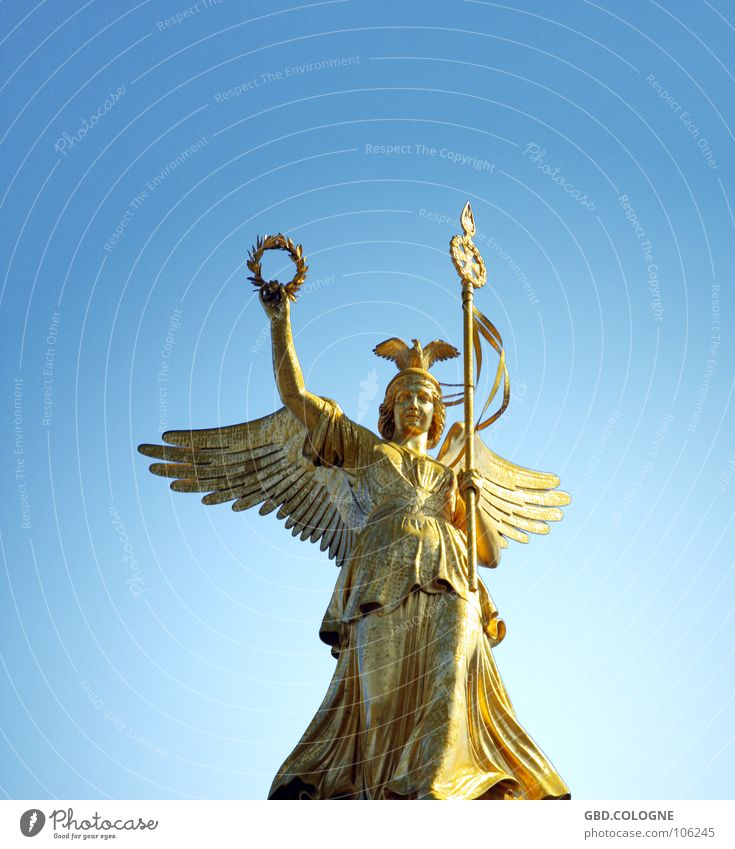 Sky Blue Berlin Gold Tourism Wing Statue Monument Historic Symbols and metaphors Sculpture Landmark Greek gods Sightseeing Berlin zoo Nike