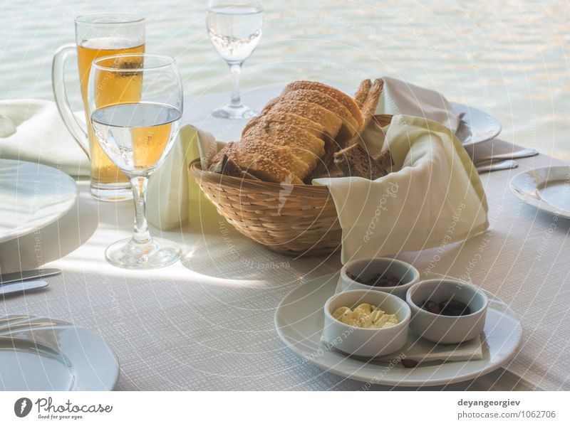 Close up table in greek restaurant. Olives and bread Green White Black Dish Table Delicious Breakfast Restaurant Bread Plate Dinner Greece Salad Vegetarian diet