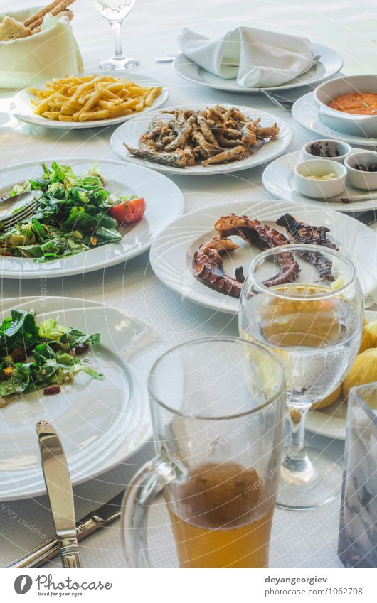 Table in greek restaurant. Salat and fish Green White Ocean Dish Delicious Breakfast Restaurant Bread Plate Meal Dinner Lunch Greece Tomato Salad