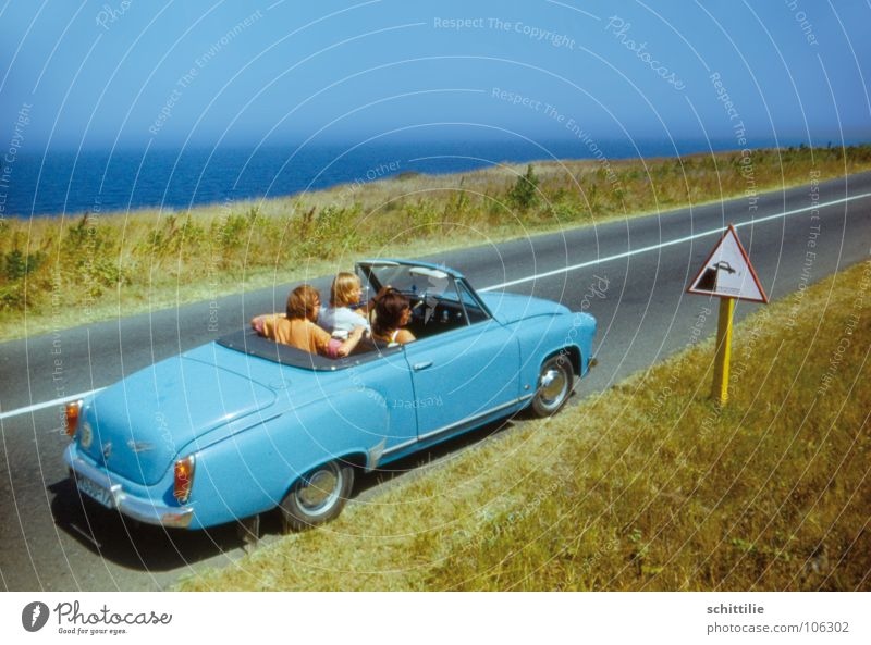ouch... how now? Slope Meadow Transport Road sign Ocean Green Car driver Gray Nostalgia Seventies East Cyan Grass Driving Places Summer Group Blue Human being