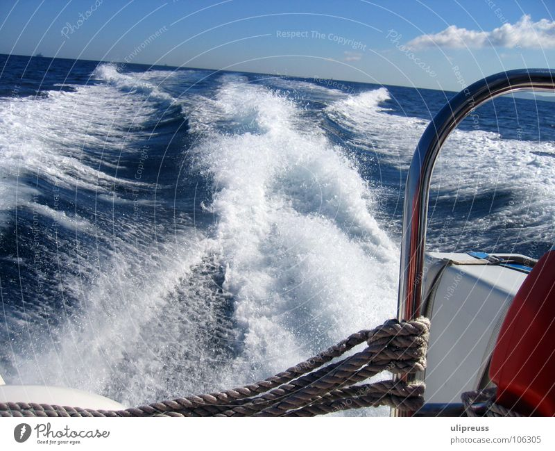 Water Sky White Ocean Blue Red Vacation & Travel Far-off places Relaxation Lanes & trails Watercraft Waves Speed Navigation Foam White crest