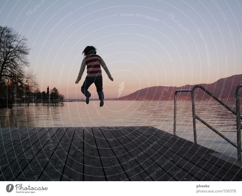 JuMp ARoUnd Jump Summer Physics Lake Footbridge Wood Sunset July Lake Attersee Joy Warmth Wooden board Energy industry Swimming & Bathing