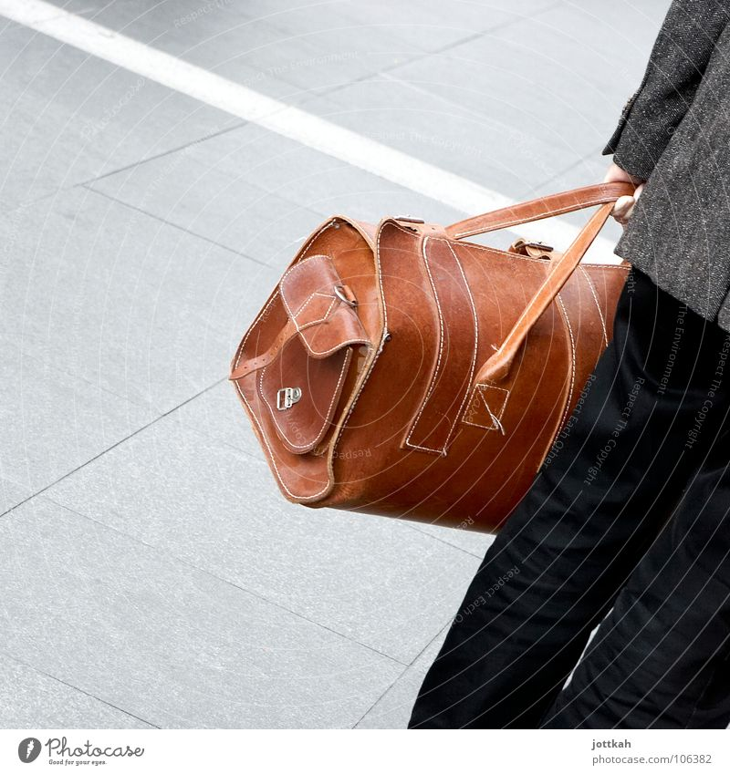 Standing at an angle because the travel bag is too heavy. Bag Traveling bag Suitcase Luggage Vacation & Travel Depart Leather Brown Man To hold on Square