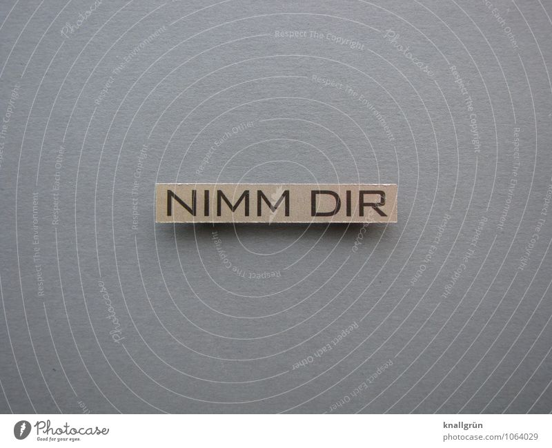 NIMM DIR Characters Signs and labeling Communicate Sharp-edged Brown Gray Black Emotions Hospitality Friendliness share Give Demand Colour photo Studio shot