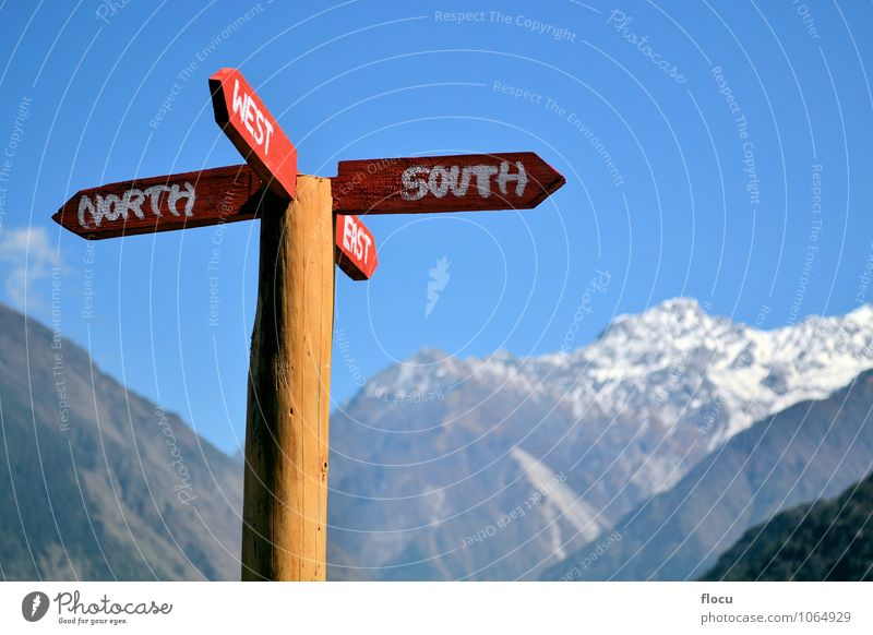 Signpost with directions in the mountains Vacation & Travel Summer Mail Horizon journey trip east house path himalayas way road south west north compass