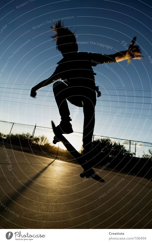 Skateboarder in silhouette Youth (Young adults) Skateboarding Trick Jump Sunset Extreme sports boy teenage Sports skinny youth young rebel hair Parking level