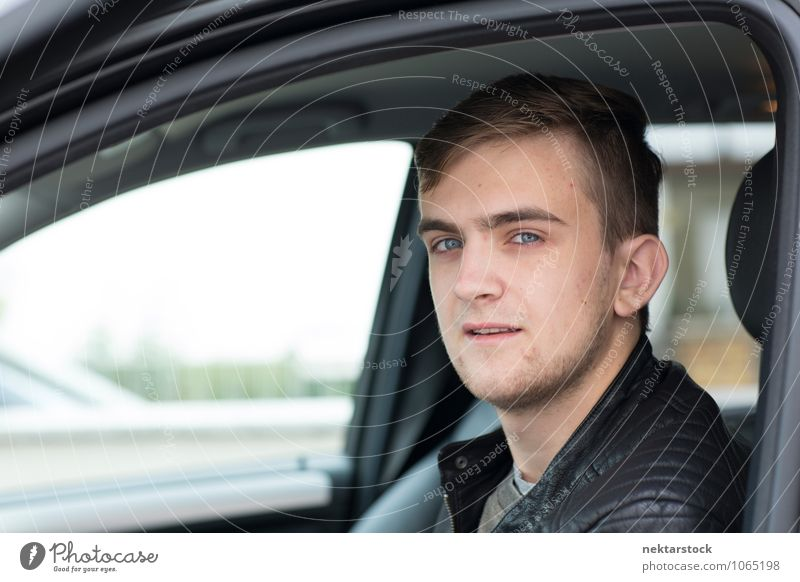 Portrait of Young Man in Drivers Seat of Car Human being Young man Youth (Young adults) Face 1 18 - 30 years Adults Driving driver's seat Caucasian Close-up Day