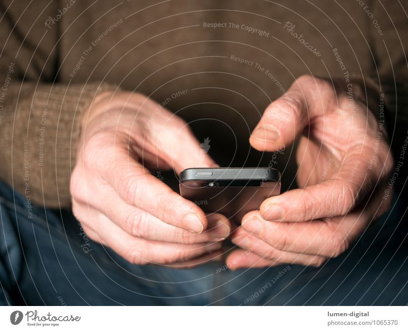 Hands with Smartphone Cellphone PDA Fingers Communicate Sit To call someone (telephone) Chat clipping device electronic hands holding jeans man sitting sweater