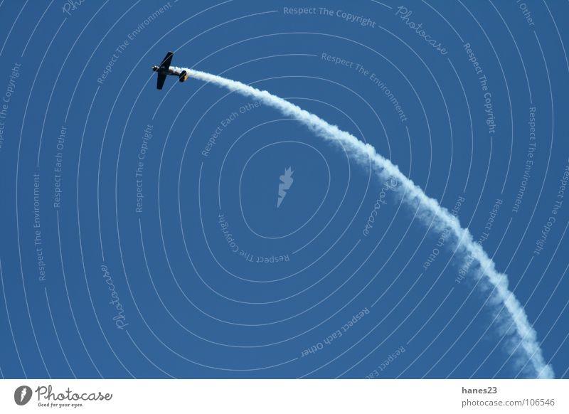 Ju-Days Airplane Aerobatics Bow Vapor trail Sky Motorsports Leisure and hobbies Aviation Blue Roller coaster