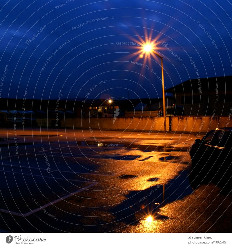 keep the car running Light Parking lot Puddle Lantern Asphalt Street lighting Reflection Wall (barrier) Loneliness Calm Cold Physics Truck Excavator Services