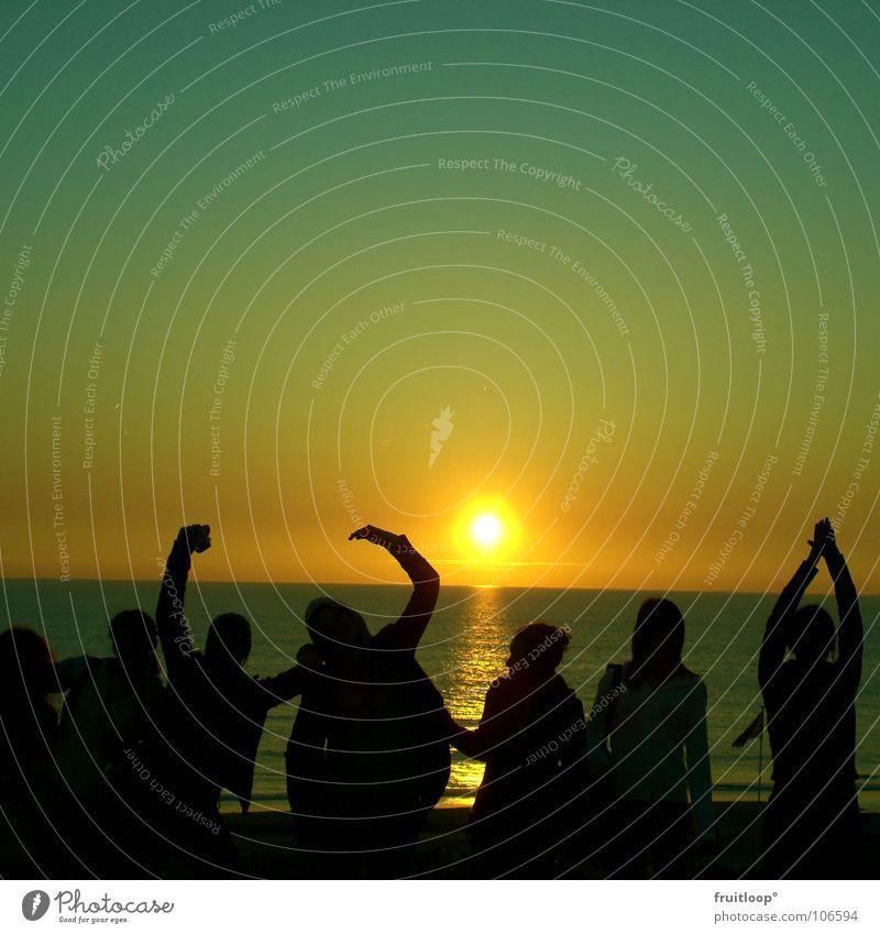 human, stretch yourself! Moody Society Friendship Vacation & Travel Events Ocean Sun Evening Human being Shadow Arm North Sea Colour Sky Joy gazing Illuminate