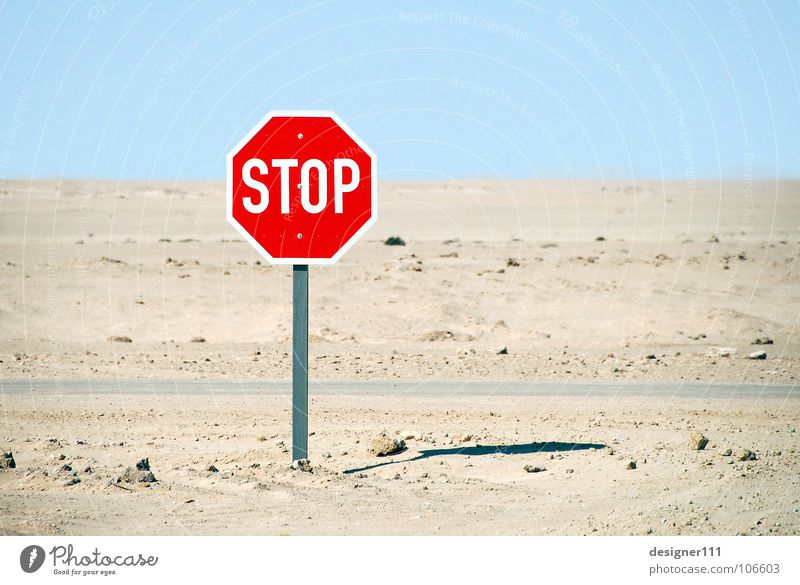 STOP Mountain Sand Climate change Drought Desert Street Lanes & trails Truck Signs and labeling Graffiti Hot Cold Above Under Blue Yellow Green Red Black White