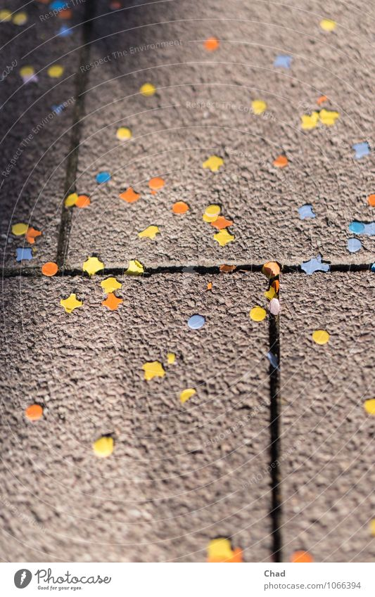 Carnival Rest Joy Feasts & Celebrations Fairs & Carnivals Birthday Lanes & trails Sidewalk Footpath Confetti Paper Stone Concrete Happiness Town Blue Yellow
