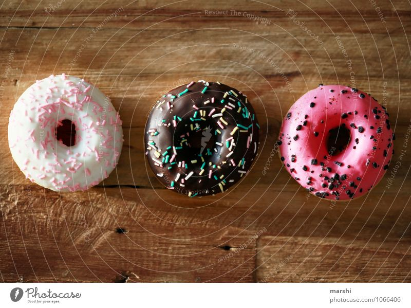 CaloriesHighThree Food Dessert Candy Nutrition Eating Fasting Emotions Moody Rich in calories Donut Delicious Round Granules Wooden table Colour photo