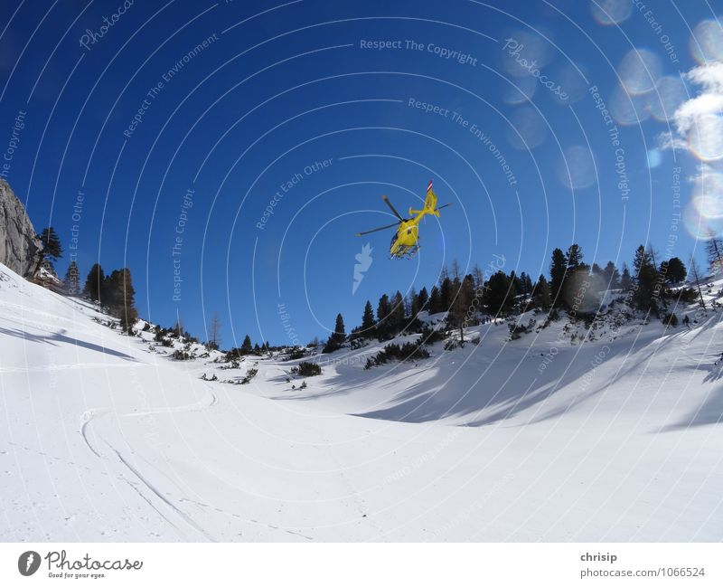 SHOOTING... yellow angel Landscape Sky Cloudless sky Winter Beautiful weather Snow Tree Alps Aviation Helicopter Rescue helicopter Running Flying Happy Blue