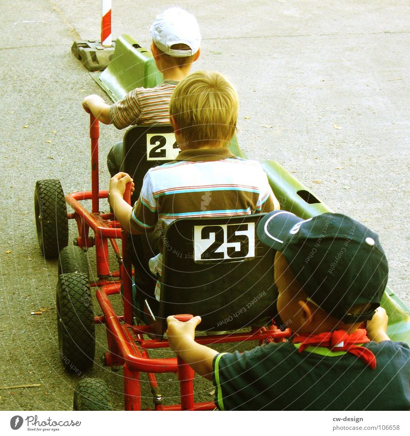 at full throttle! Child Playground Playing Driving Stand Sandpit Sporting grounds Traffic lane Racecourse Stop Signage Warning sign Roadside Lane markings