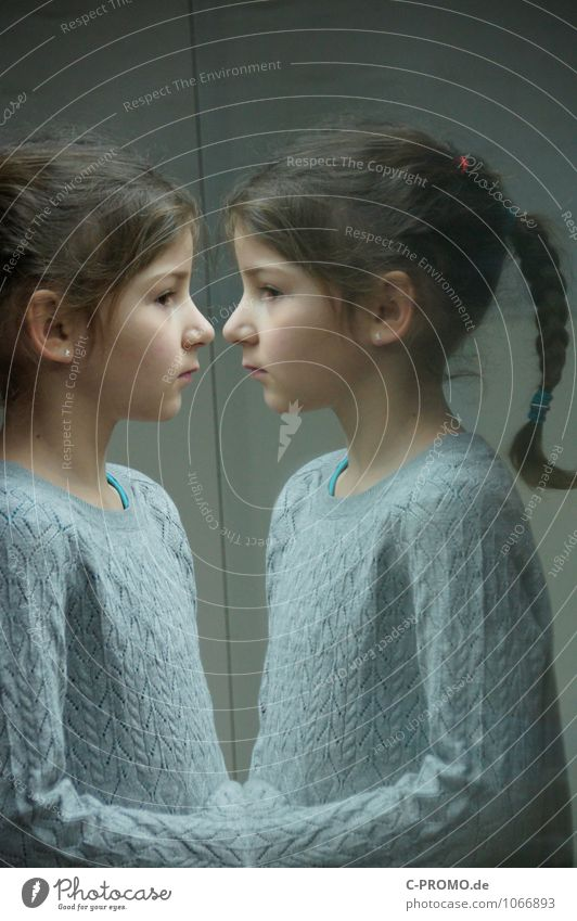 Mirrored girl 6 Child Human being Feminine Sister Friendship Infancy 3 - 8 years Sweater Earring brunette Glass Sadness Curiosity Gray Loneliness Perspective