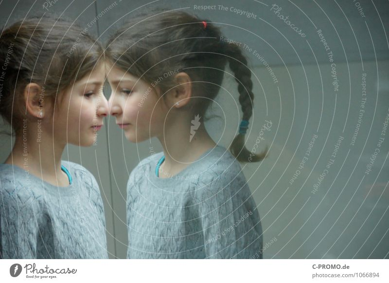 Mirrored girl 1 Human being Feminine Sister Friendship Infancy Head 2 3 - 8 years Child Sweater Earring brunette braid Glass Looking Curiosity Gray Loneliness