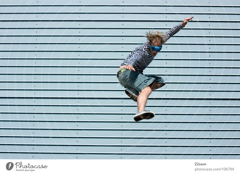 Human being Sky Man Blue Clouds House (Residential Structure) Architecture Hair and hairstyles Jump Flying Arm Modern High-rise Action Perspective Cool (slang)