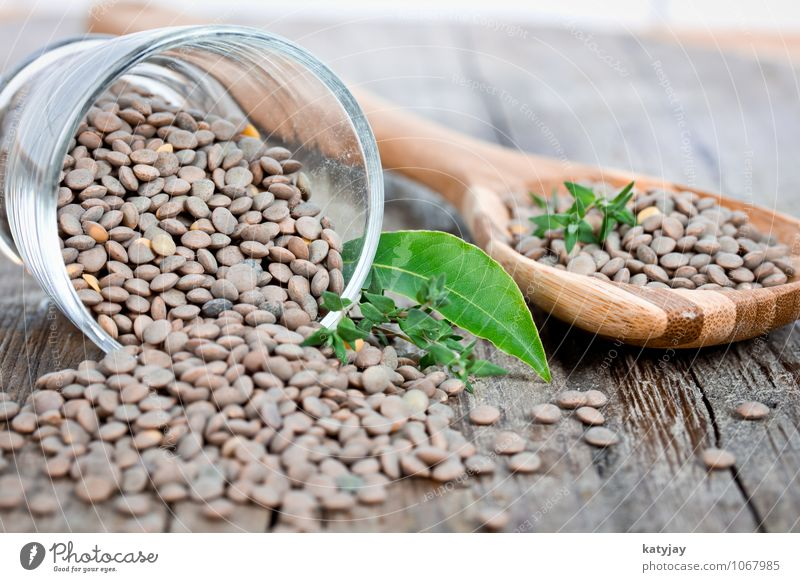 peep Food Herbs and spices Nutrition Eating Lentils plate lenses Legume Dried Cooking Ingredients Bay leaf Thyme Close-up Wooden board Wooden table Vegetable