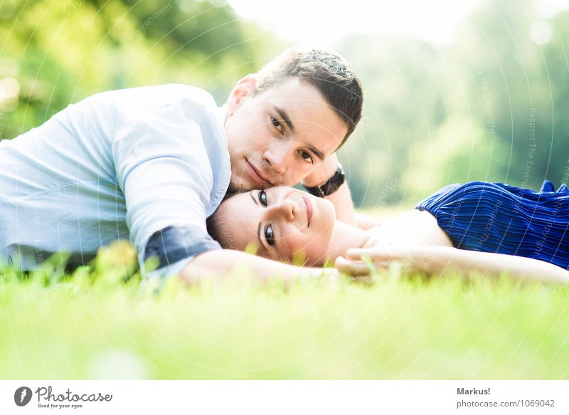 close Human being Masculine Feminine Woman Adults Man Couple 2 18 - 30 years Youth (Young adults) Smiling Love Lie Happiness Healthy Happy Bright Blue Yellow