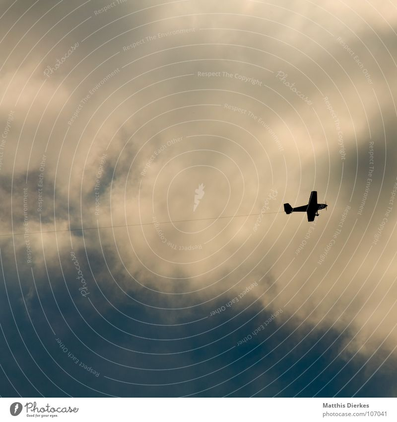 BY LAW. Airplane Clouds Dangerous Environment Environmental pollution Fastening Bird Bird's-eye view Sailplane Small Diminutive Direction Trend-setting Aviation