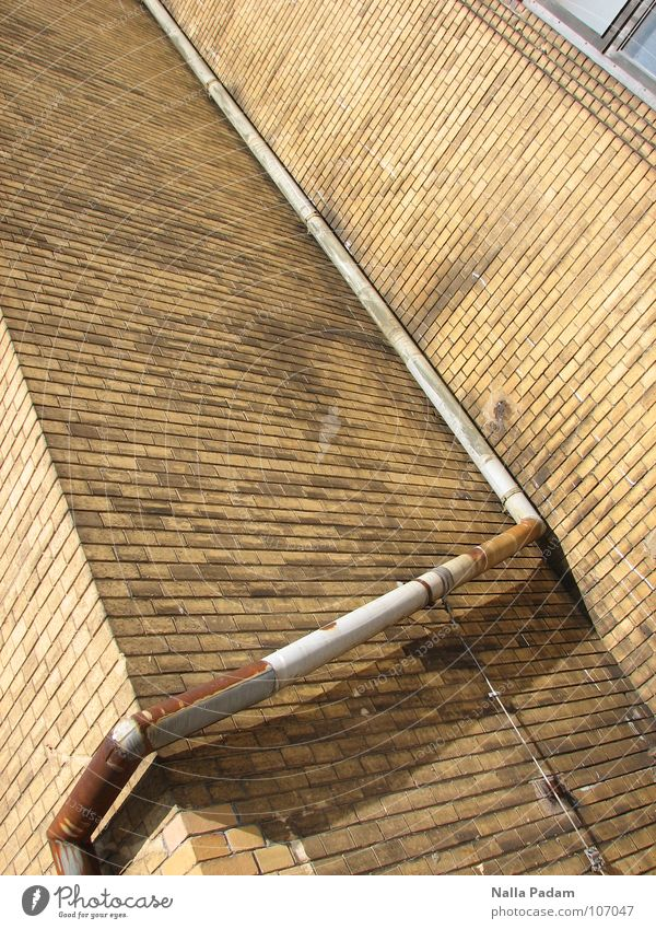 Simple downpipe or The art of steering water Wall (building) Brick Ochre Downspout Sharp-edged Historic Drainage Roof Downward Industry Stone Downpipe Rust