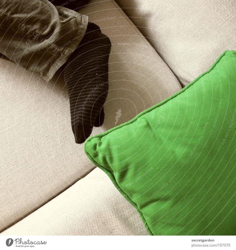 still life with pillows and socks Striped socks Stockings Cushion Clothing Pants Green Khaki Black Gray Sofa Sleep Horizontal Material Calm Stationary Man