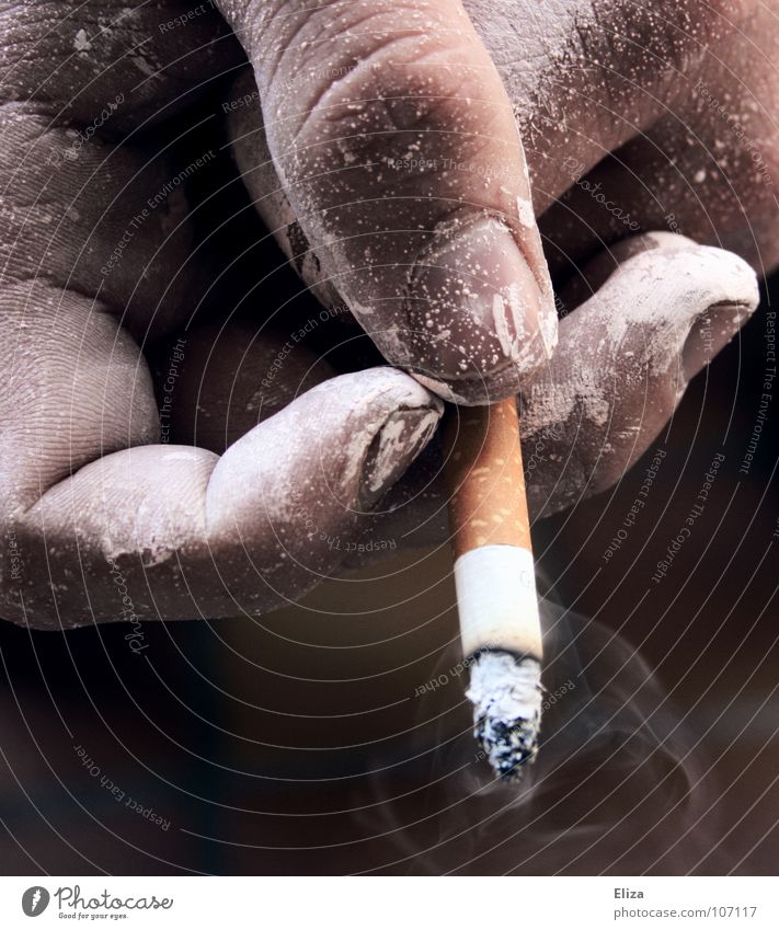 A hand of a smoker with a burning cigarette and smoke, sprinkled with white paint Smoking Human being Painter Masculine Man Adults Hand Fingers Vice