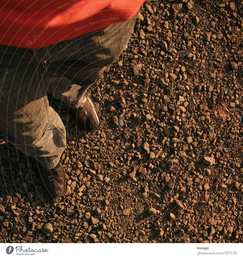 Man Loneliness Stone Footwear Wait Going Walking Trip T-shirt Stand To go for a walk Floor covering Pants Gravel Pebble