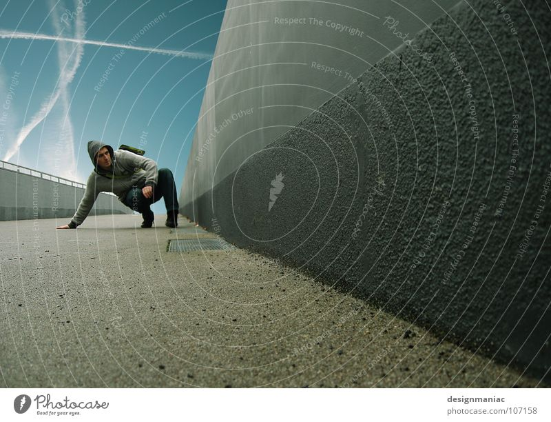 Extreme traction Matrix Style Concrete Gray Black Man Jump Hover Air Weightlessness Vapor trail Dark Hero Steep Vanishing point Wall (building) Wall (barrier)