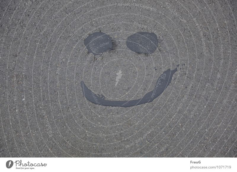 all well Face Eyes Mouth Street Laughter Happiness Gray Joy Asphalt Tar Repaired Funny Colour photo Exterior shot Downward